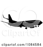 Clipart Black And Gray Commercial Airplane 4 Royalty Free Vector Illustration