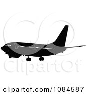 Clipart Black And Gray Commercial Airplane 3 Royalty Free Vector Illustration