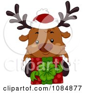 Clipart Christmas Reindeer Holding Up A Gift Royalty Free Vector Illustration