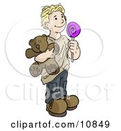 Blond Boy Holding A Lolipop Sucker And A Teddy Bear