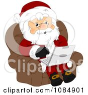 Santa Claus Sitting And Using A Laptop