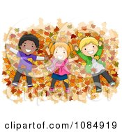 Diverse Kids Laying In A Pile Of Autumn Leaves