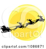 Silhouetted Santa Sleigh And Flying Reindeer Against The Christmas Eve Moon