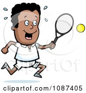 Black Tennis Boy Swinging His Racket At The Ball