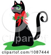 Black Cat Wearing A Christmas Bow And Holly