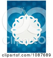 White Paper Snowflake Tag Over Blue Snowflakes
