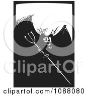 Clipart Woodcut Devil With A Pitchfork Black And White Royalty Free Vector Illustration