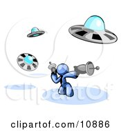 Blue Man Fighting Off UFOs With Weapons Clipart Illustration by Leo Blanchette
