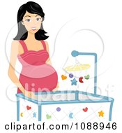 Pregnant Woman Standing By A Crib