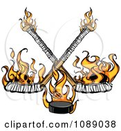 Clipart Flaming Hockey Puck And Crossed Sticks Royalty Free Vector Illustration by Chromaco