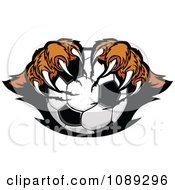 Clipart Tiger Mascot Clawing A Soccer Ball Royalty Free Vector Illustration