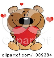 Clipart Valentine Teddy Bear Holding A Heart Royalty Free Vector Illustration