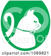 Clipart White Profiled Cat Over A Green Oval Logo Royalty Free Vector Illustration