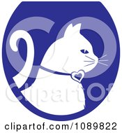 Clipart White Profiled Cat Over A Blue Oval Logo Royalty Free Vector Illustration