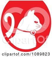 Clipart White Profiled Cat Over A Red Oval Logo Royalty Free Vector Illustration