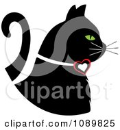 Clipart Black Profiled Cat With Green Eyes And A Heart Collar Royalty Free Vector Illustration