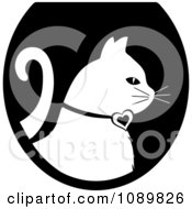 Clipart White Profiled Cat Over A Black Oval Logo Royalty Free Vector Illustration