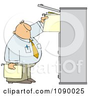 Businessman Reaching For Folders In A Tall Cabinet