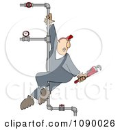 Male Plumber Playing On A Vertical Pole Of Pipes