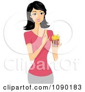 Young Asian Woman Eating French Fries