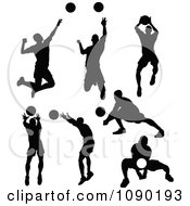 Silhouetted Male Volleyball Players
