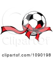 Clipart Soccer Ball With A Red Ribbon And Bow Royalty Free Vector Illustration by Chromaco