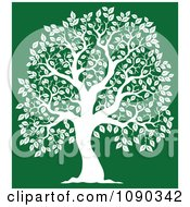 Clipart White Tree Silhouette On Green Royalty Free Vector Illustration