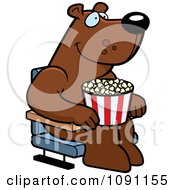 Clipart Happy Bear With Popcorn At The Movie Theater Royalty Free Vector Illustration