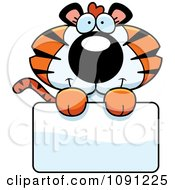 Clipart Cute Tiger Holding A Sign Royalty Free Vector Illustration