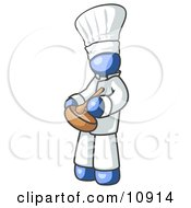 Blue Baker Chef Cook In Uniform And Chefs Hat Stirring Ingredients In A Bowl