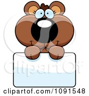 Clipart Cute Bear Cub Holding A Sign Royalty Free Vector Illustration