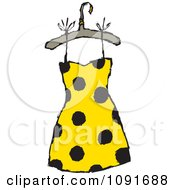 Yellow Dress With Black Polka Dots On A Hanger