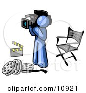 Blue Man Filming A Movie Scene With A Video Camera In A Studio