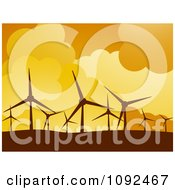 Turbines Silhouetted Against An Orange Sky At A Wind Farm