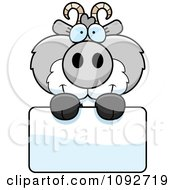 Clipart Cute Gray Goat Holding A Sign Royalty Free Vector Illustration