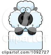 Clipart Cute Baby Sheep Holding A Blank Sign Royalty Free Vector Illustration