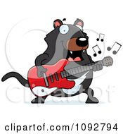 Clipart Chubby Tazmanian Devil Guitarist Royalty Free Vector Illustration by Cory Thoman