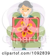 Clipart Senior Woman Holding Up A Floral Quilt Royalty Free Vector Illustration