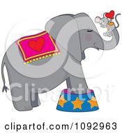 Clipart Circus Elephant With A Mouse Holding A Heart On His Trunk Royalty Free Vector Illustration