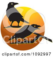 Clipart Silhouetted Crows Over An Orange Circle Royalty Free Vector Illustration