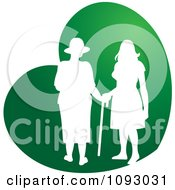 Clipart Silhouetted Nurse Helping An Elderly Woman With A Cane Over A Green Heart Royalty Free Vector Illustration