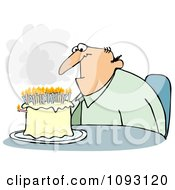 Depressed Middle Aged Man Sitting In Front Of A Birthday Cake With Smoking Candles