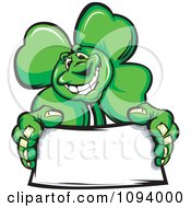 Clipart St Patricks Day Shamrock Clover Holding A Blank Sign Royalty Free Vector Illustration