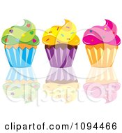 Cupcakes With Green Yellow And Pink Frosting And Sprinkles With A Reflection