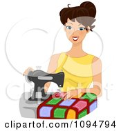 Happy Brunette Woman Sewing A Quilt