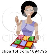 Clipart Happy Black Woman Smiling And Sewing A Quilt Royalty Free Vector Illustration by BNP Design Studio
