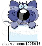 Clipart Chupacabra Holding A Sign Royalty Free Vector Illustration by Cory Thoman