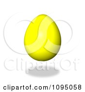 Clipart 3d Floating Yellow Easter Egg And Shadow Royalty Free CGI Illustration