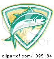 Clipart Retro Bluefin Tuna Fish Jumping Over A Sunshine Shield Royalty Free Vector Illustration