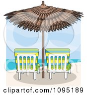 Beach Lounge Chairs Under A Straw Umbrella Facing Towards The Sea